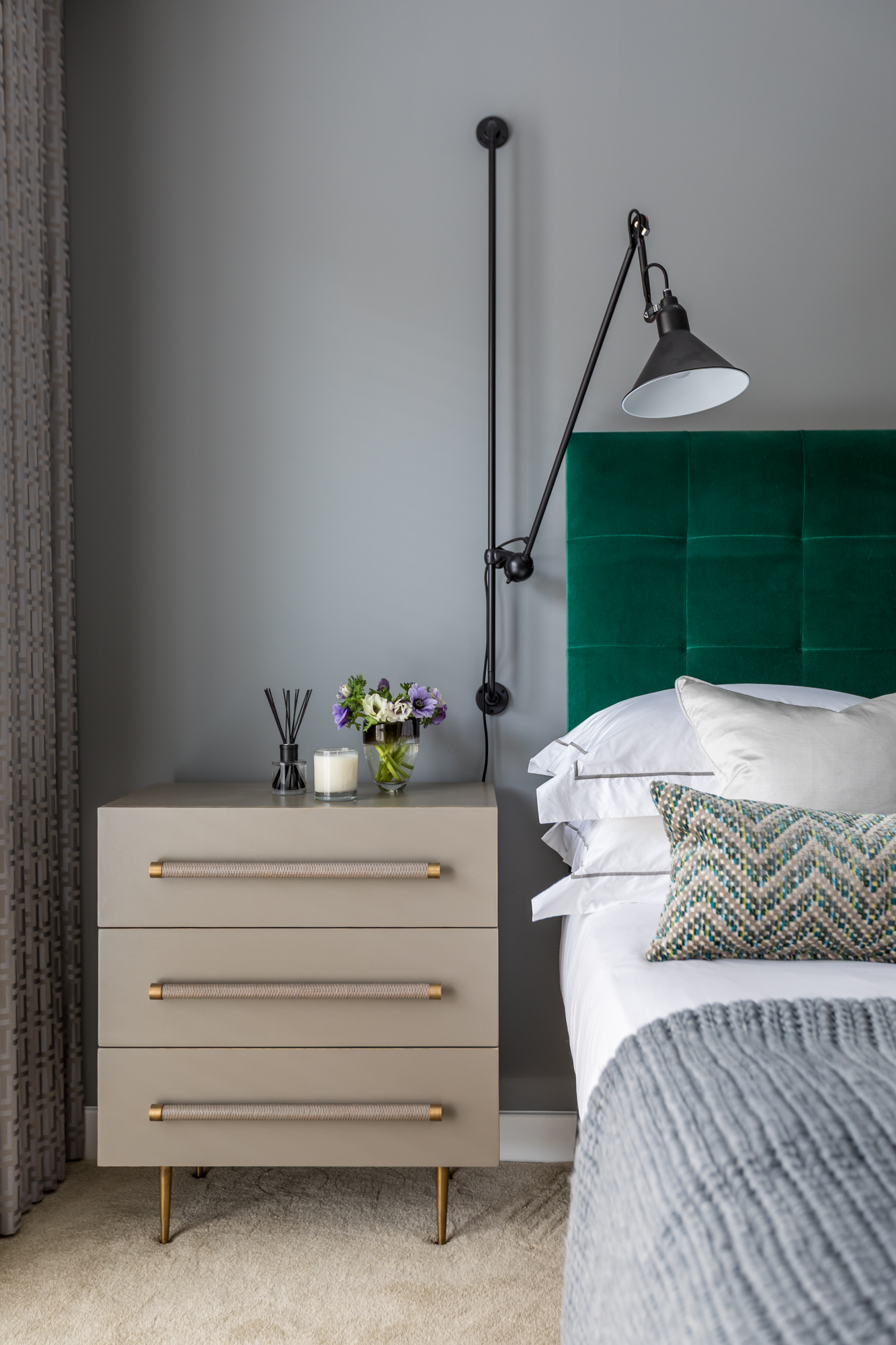 jonathan bond, interior photographer, gray bedside cabinet, wall lamp & double bed, cambridgeshire