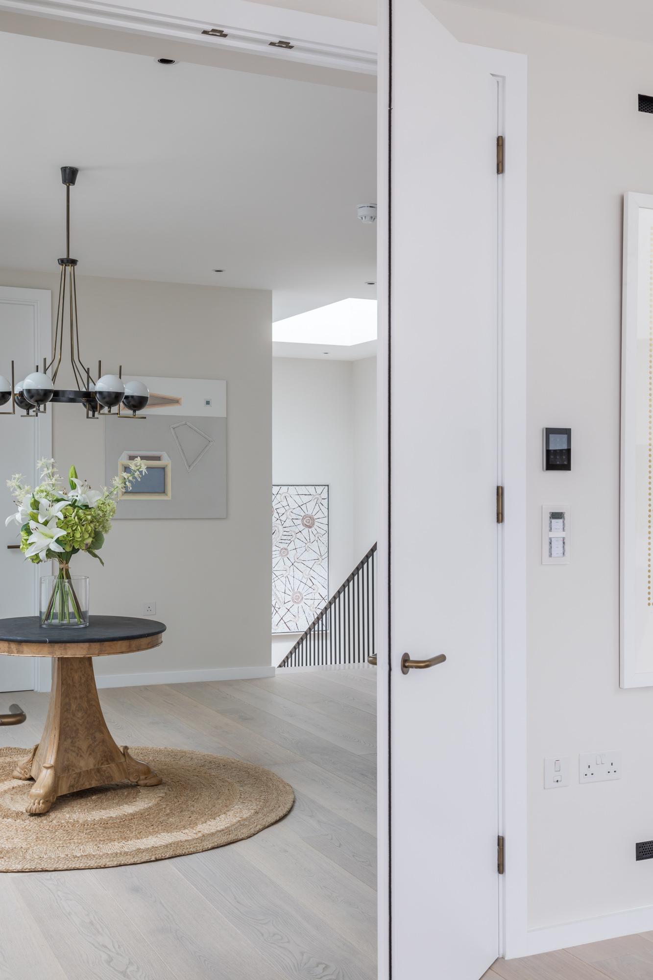 jonathan bond, interior photographer, bedroom view of round table in hallway, battersea, london