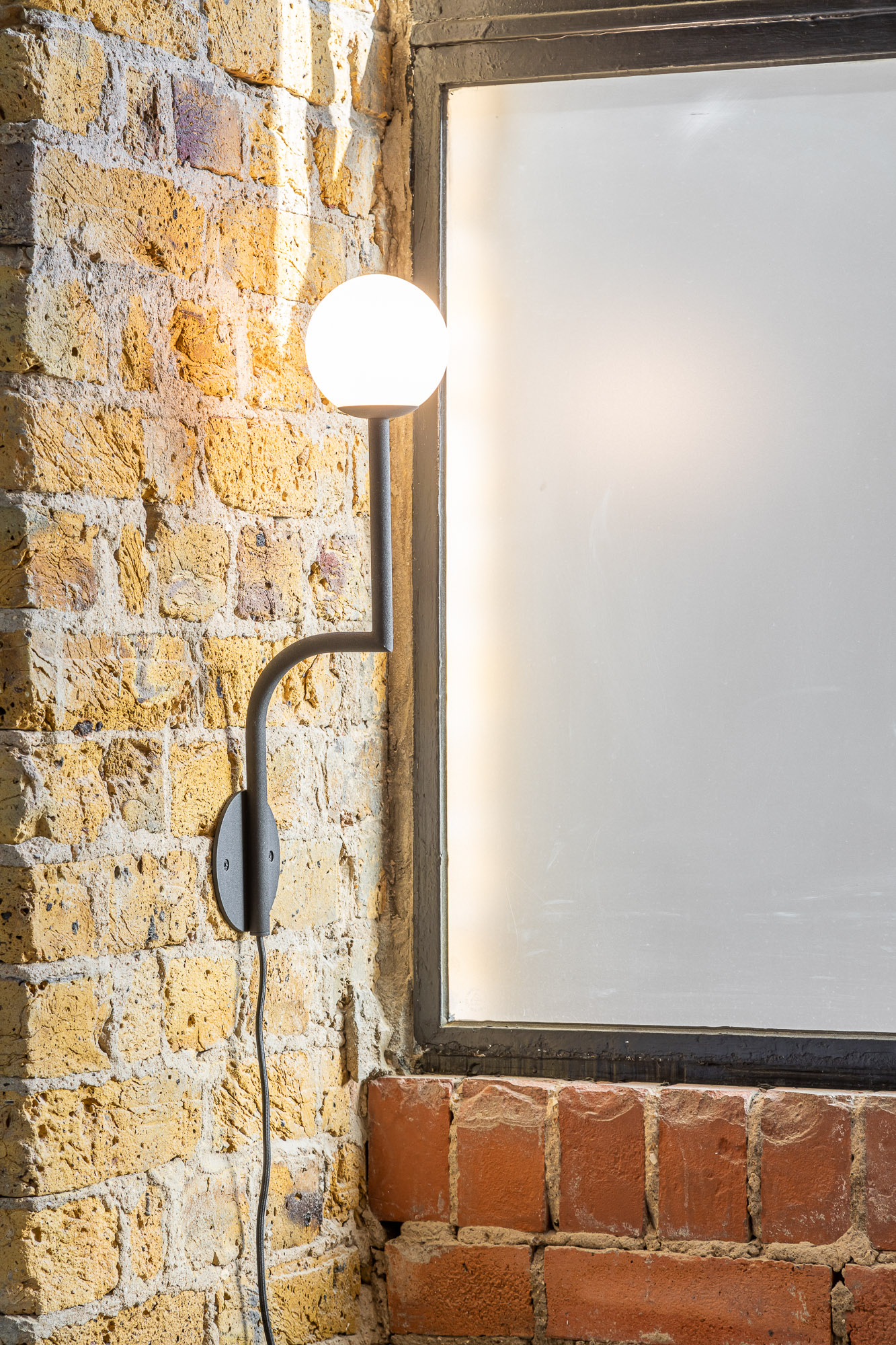 jonathan bond, interior photographer, hanging wall light by window, made with love, london