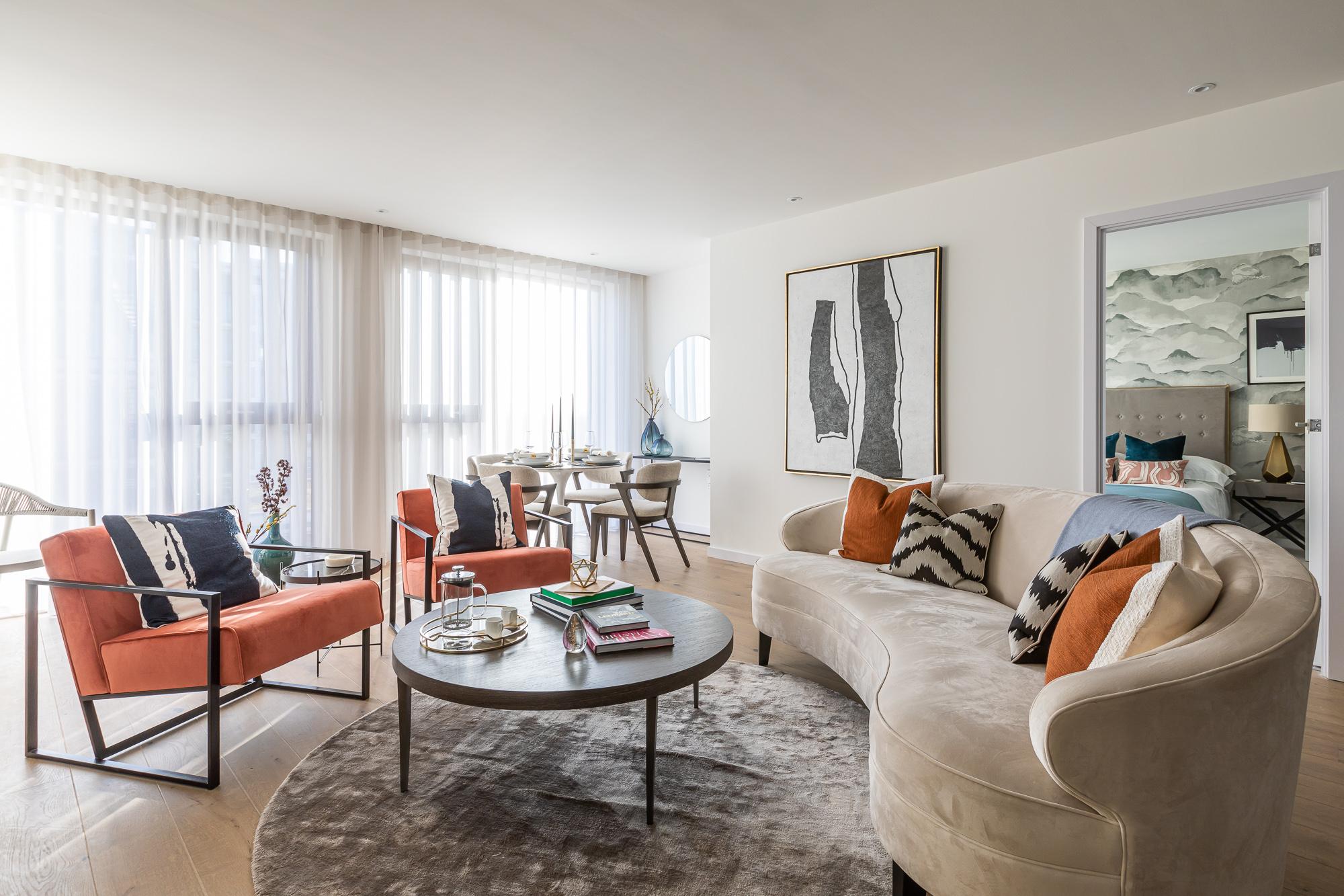 jonathan bond, interior photographer, round coffee table & sofas in living room, putney london