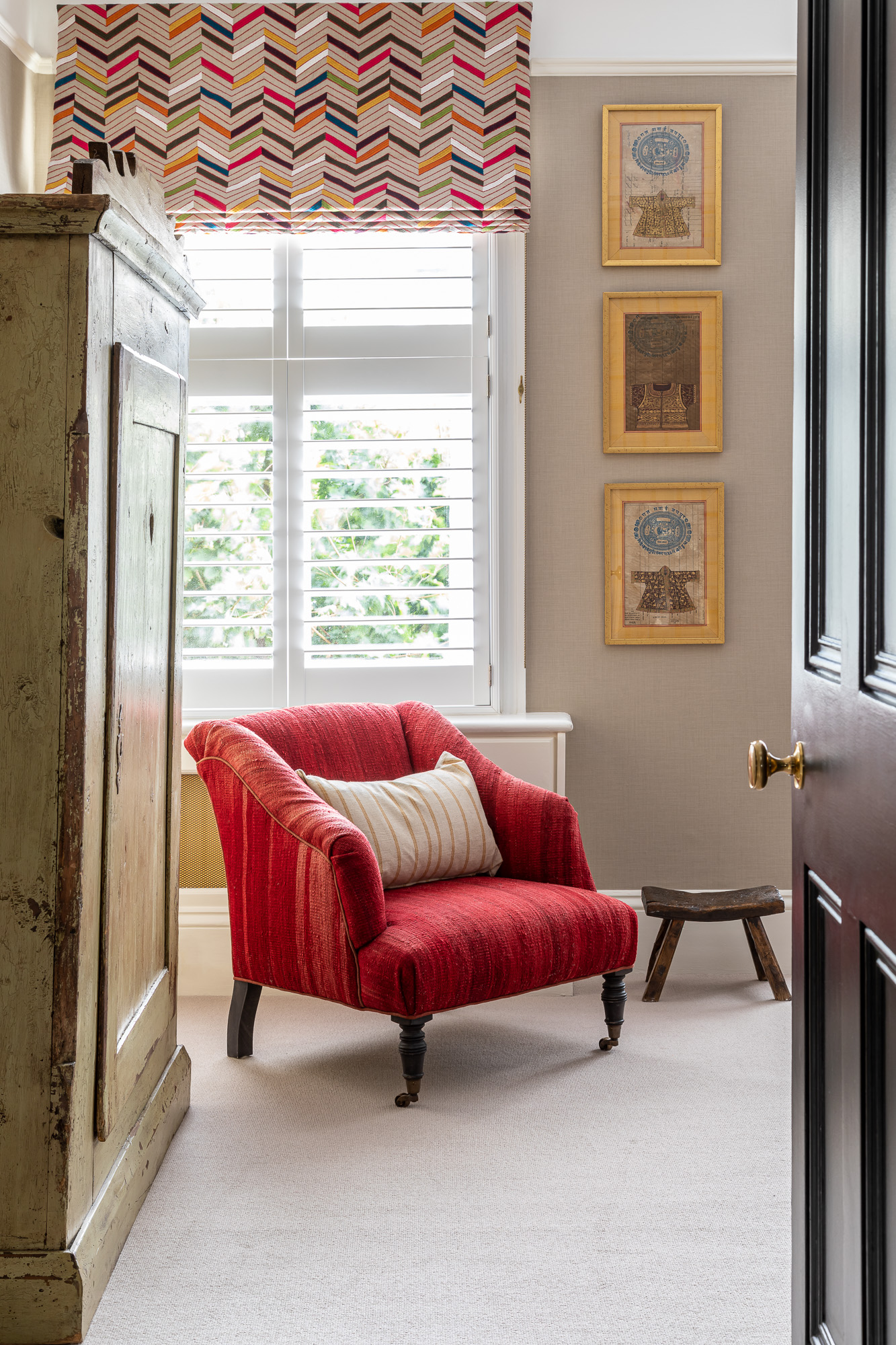jonathan bond, view of bedroom from hallway of red armchair, clapham, london