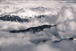 snow covered mountains in the cloud