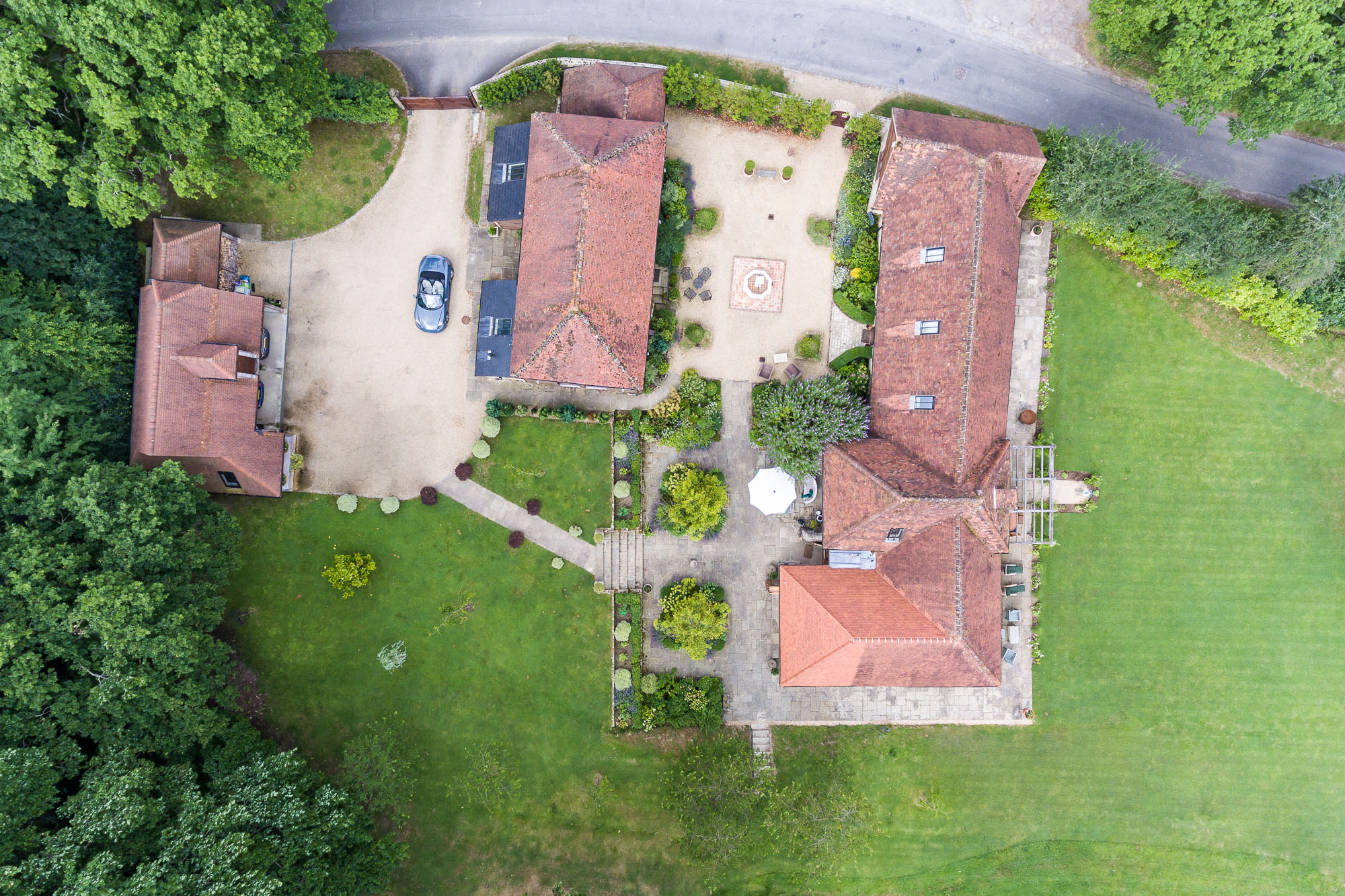 jonathan bond aerial photographer, overhead view of detached houses using drone