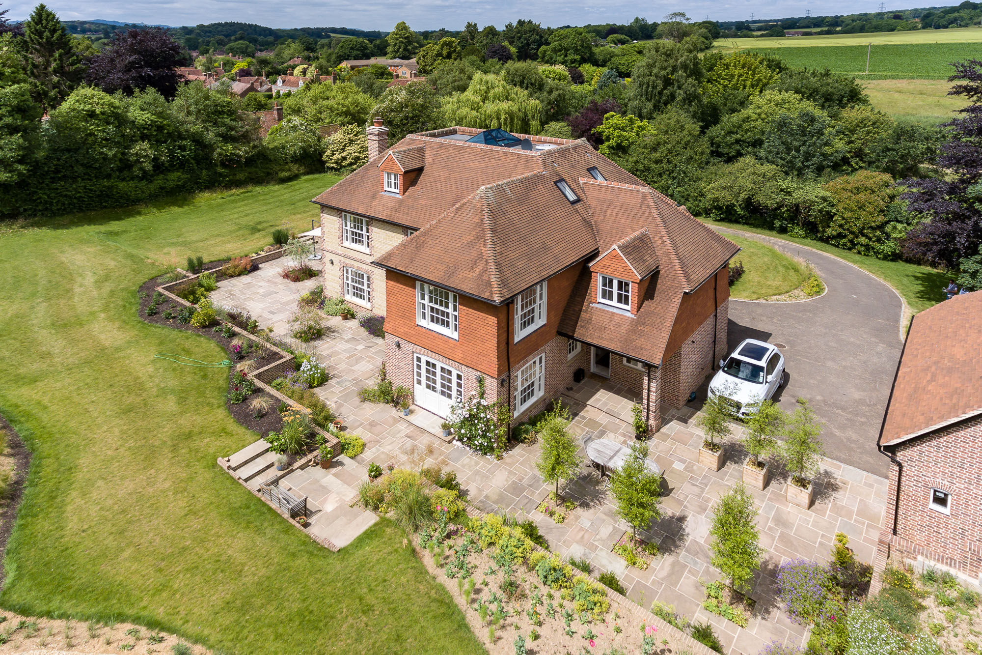 jonathan bond aerial photographer, detached residential house garden view