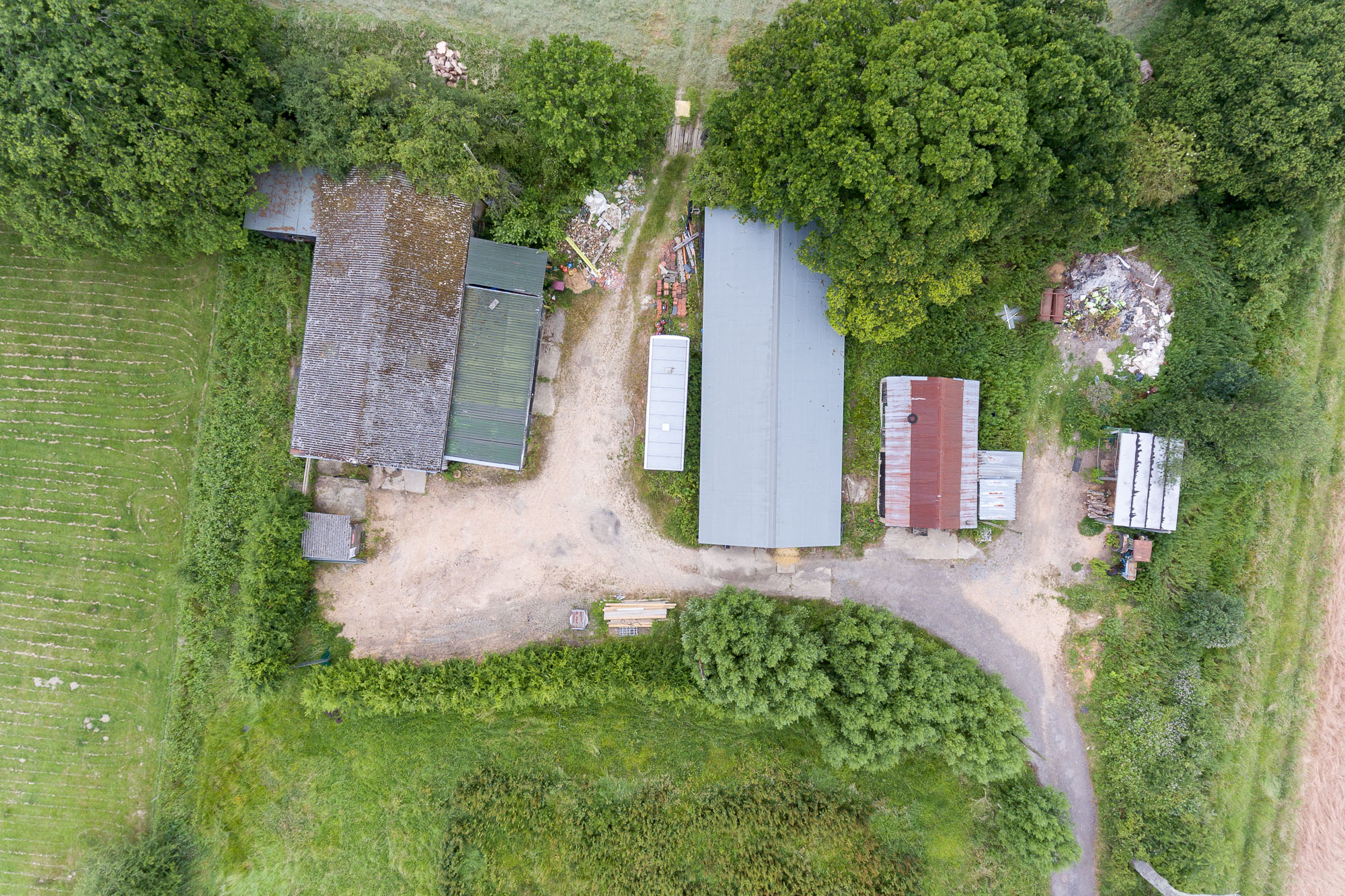 jonathan bond photography, aerial drone overhead view of rooves of a commercial farm