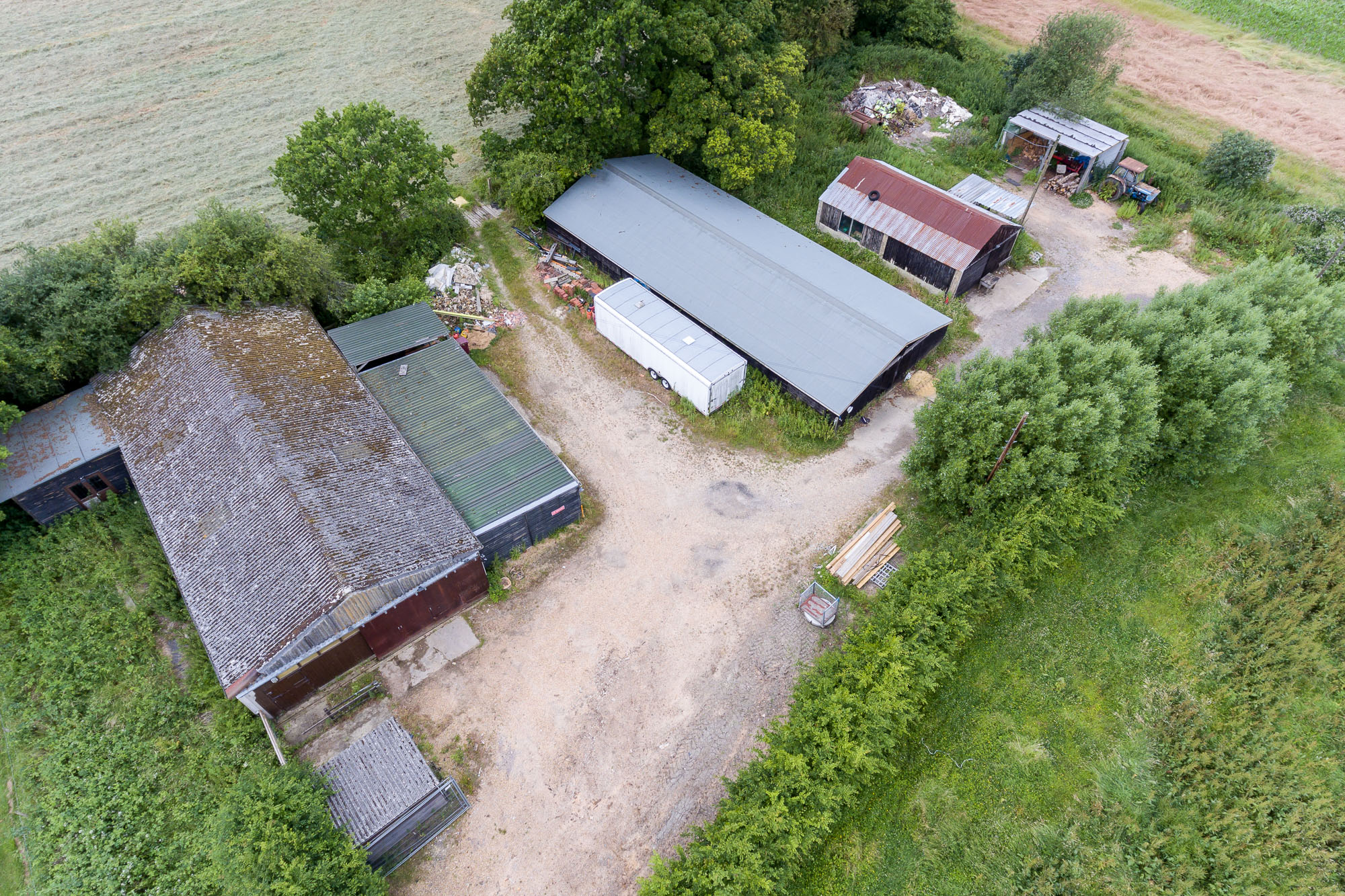jonathan bond photography, aerial drone view of rooves of a commercial farm