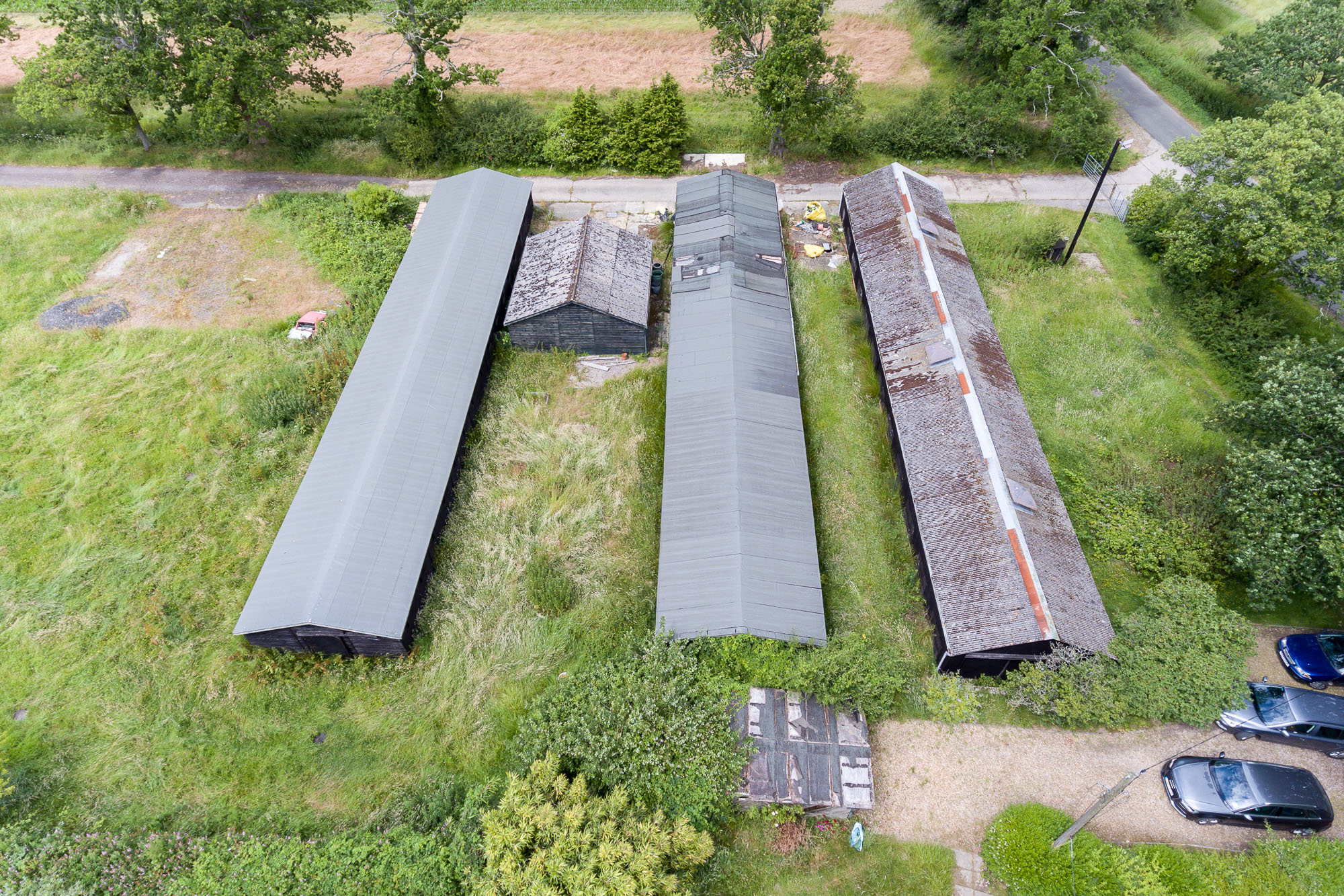 jonathan bond photography, aerial drone view of roofs for commercial buildings in fields