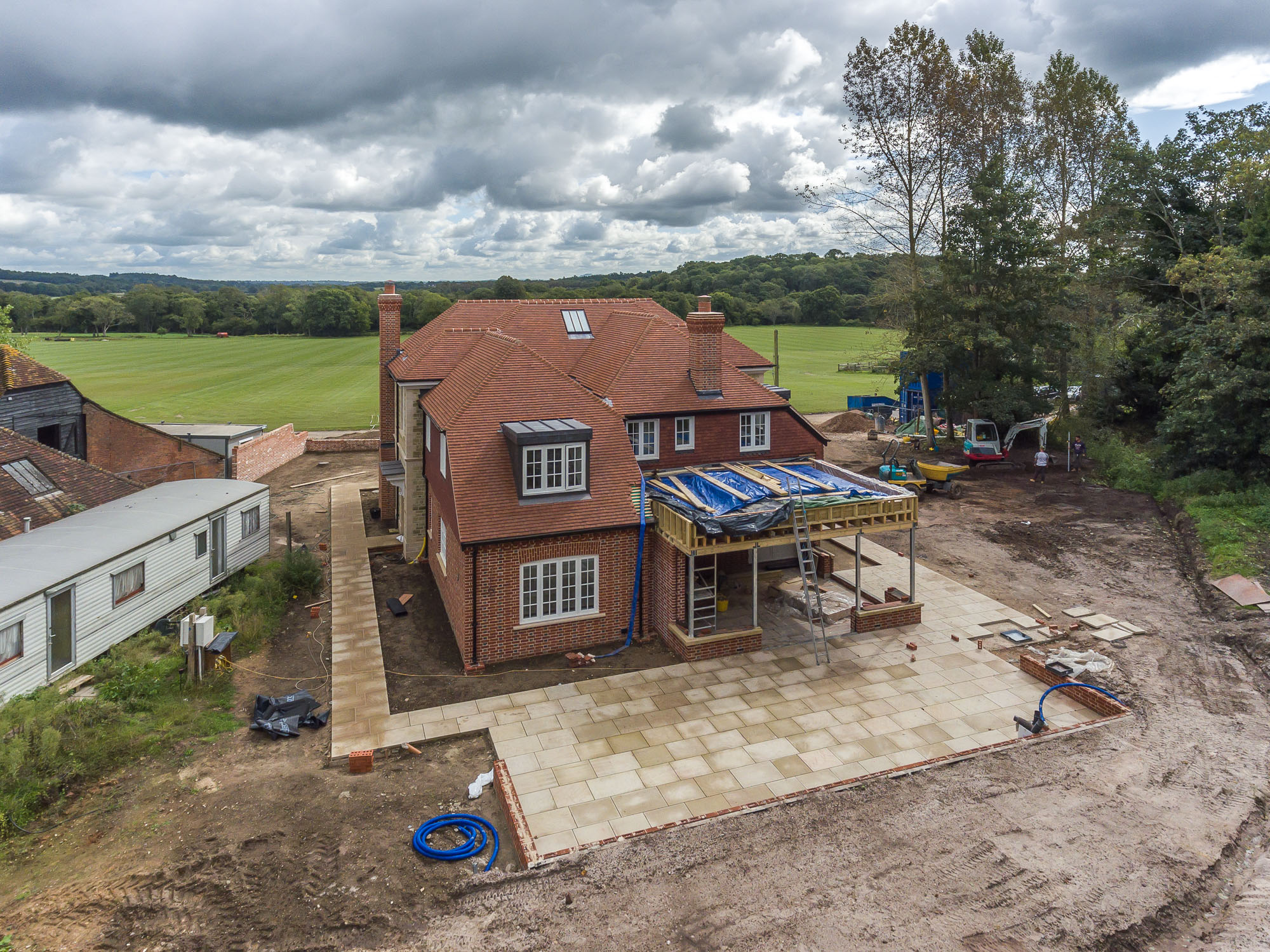 jonathan bond aerial photographer, view of detached house building work using drone