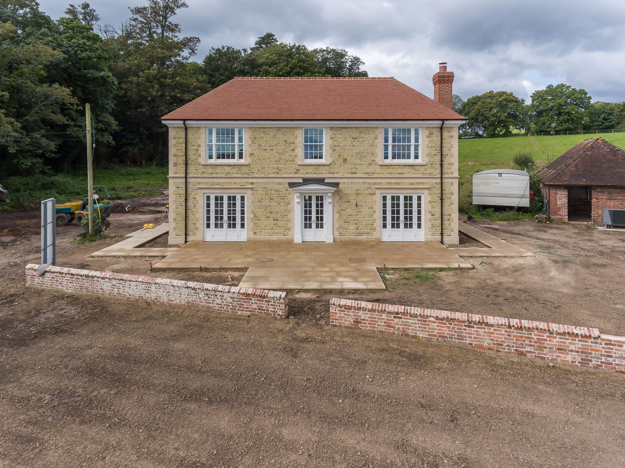 jonathan bond aerial photographer, front view of detached house using drone