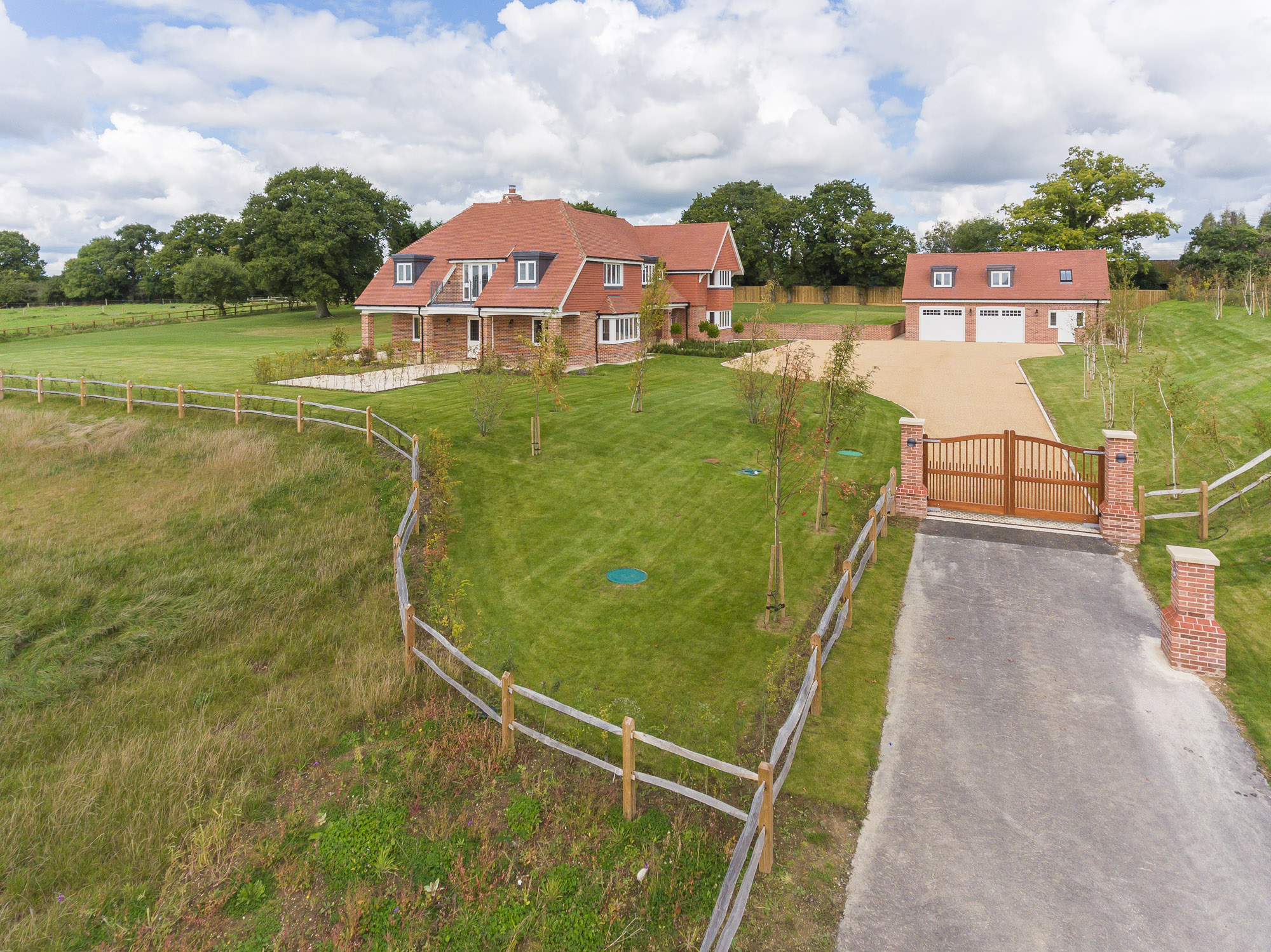 jonathan bond aerial photographer, aerial drone view of driveway to residential house