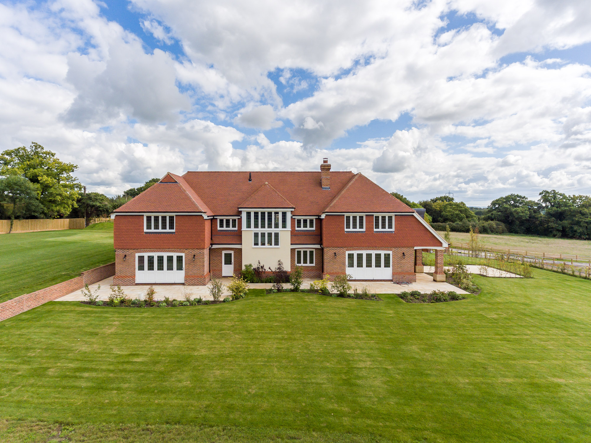 jonathan bond photography, aerial drone view of back of detached residential house